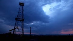 HD Fossil Fuel Energy, Oil Pump, Pumpjack, Old Pumping Unit, Thunderstorm, Rain Stock Footage