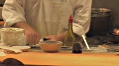 Busy Restaurant Kitchen Cook Places Plate on Counter 24p Stock Footage