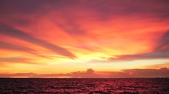 Amazing Red Sunset Sky over Ocean Stock Footage