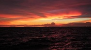 Stock Video Footage of Fading Red Sunset over Ocean