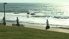 Segway driving by the seashore Stock Footage