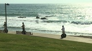 Stock Video Footage of Segway driving by the seashore
