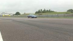 McLaren F1 supercar on race track Stock Footage
