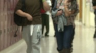 Stock Video Footage of Students walking in hallway (4 of 4)