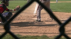 Baseball player swings at strike Stock Footage