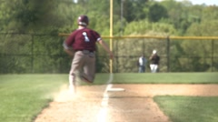 Runner tags up at third - stock footage