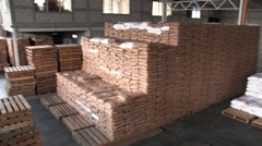 Pan of warehouse of USAID food and empty pallets Stock Footage