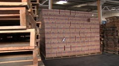 Pan of USA AID boxes and empty pallets - stock footage