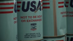 Close up of cans of  USAID vegetable oil Stock Footage