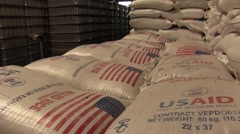 USAID bags of rice stacked in warehouse - stock footage