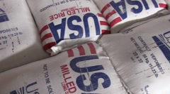 Bags of USA Aid Milled rice Stock Footage