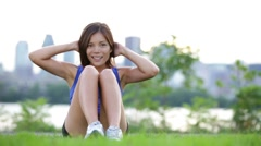 Fitness woman situps in city park Stock Footage