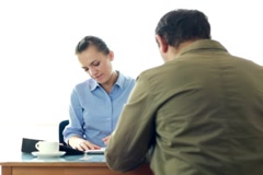 Real estate agent signing contract and giving keys to male client NTSC - stock footage