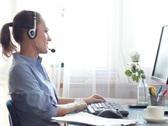 Attractive helpdesk consultant smiling to the camera NTSC Stock Footage