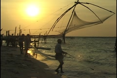 Cochin Fishing Nets at Sunset Kerala India Stock Footage