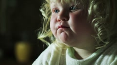 little girl stares cartoons - stock footage