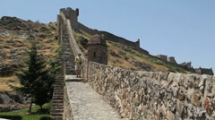 Portugal Marvao city walls climb hill behind tourist Stock Footage