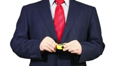 Businessman using a measuring tape. Stock Footage