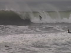 Sequence of waves and surfers Stock Footage