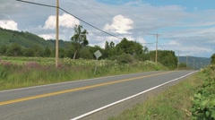 Passenger Car Driving By on Rural Highway Stock Footage