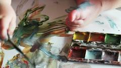Child draws paints closeup Stock Footage
