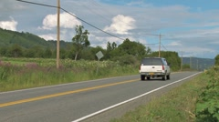 Big SUV and Small Car on Rural Highway Stock Footage