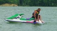 Daughter Boarding Jet Ski Stock Footage