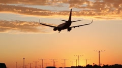 Dramatic Sunset Landing Stock Footage