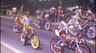 Stock Video Footage of Kids CHILDREN RIDE on Bikes in Parade 1970s Vintage Film 8mm Home Movie 445