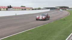 Morgan's and Porsche on race track Stock Footage