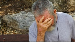 Very sad old senior man in the park MRL - stock footage