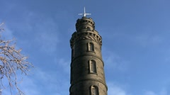 Tilt up to the tall tower of Nelson Monument Edinburgh Stock Footage