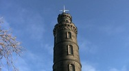 Stock Video Footage of Tilt up to the tall tower of Nelson Monument Edinburgh