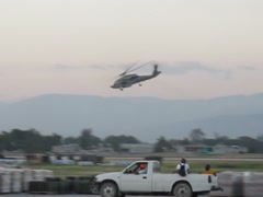 Black Hawk over Port-au-Prince Stock Footage