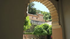 Alhambra view through arch Stock Footage