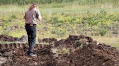 Man digging a ditch Stock Footage