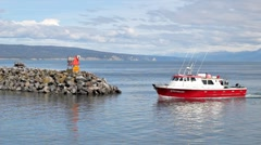 Red boat entering the harbor Stock Footage