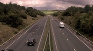 Stock Video Footage of Highway motorway in countryside with cars speeding past HD