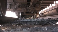 Under a train axels and trax Stock Footage