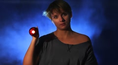 Woman shining a flashlight Stock Footage