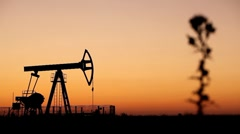 Sunset, Oil Drilling Rig Field, Jack Pumping Unit, Fossil Fuel Energy, Oil Pump - stock footage