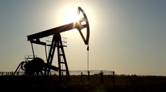 Stock Video Footage of Fossil Fuel Energy, Oil Pumps, Sunset, Oil Drilling Rig Field, Industry