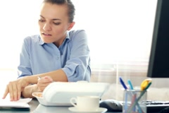Busy multitasking attractive businesswoman in the office, timelapse Stock Footage