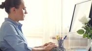 Attractive businesswoman working on computer in the office Stock Footage