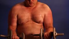Men lifting dumbbell Stock Footage