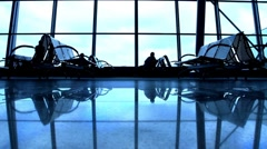 People silhouettes walking at airport space Stock Footage