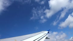The wing of commerical airplane over cloud Stock Footage