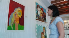 Woman Looking at Painting in Art Gallery Stock Footage