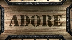 Adore on wooden stamp Stock Footage