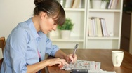 Woman looking for job with cellphone and newspaper Stock Footage